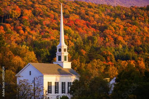 Fall foliage behind a rural Vermont church