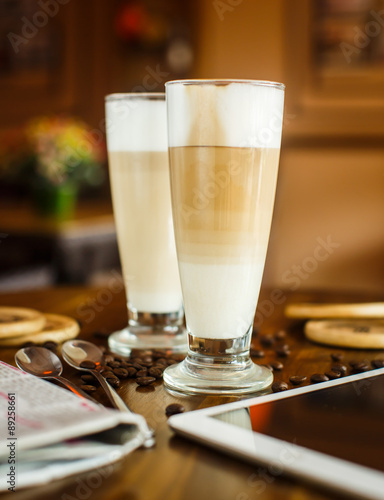 Fotografie, Obraz  2 latte on a wooden table