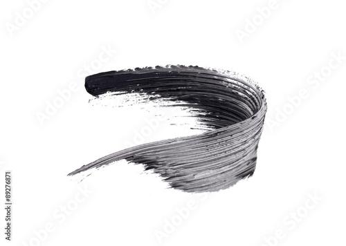 Valokuva  smear of black mascara isolated on white