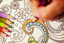 An Image Of A New Trendy Thing Called Adults Coloring Book.  In This Image A Person Is Coloring An Illustrative And Detailed Pattern For Stress Relieve . Image Has A Vintage Effect Applied.