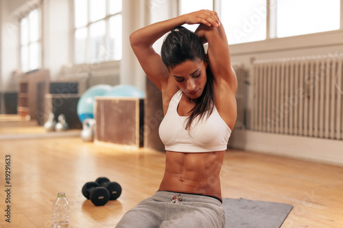 plakat Fitness woman doing stretching exercise at gym