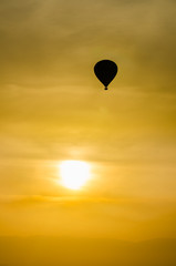 Silhouette hot air balloon on yello sky sunset