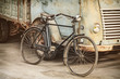 canvas print picture - Retro styled image of an ancient bike and truck
