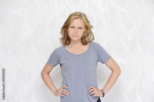 Fotografering  Portrait of dissatisfied young woman