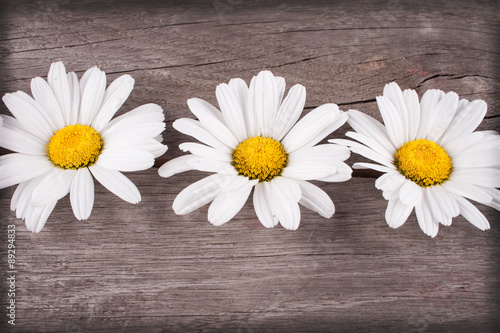Fototapeta do kuchni flowers on a wooden table