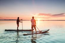 Sunset Stand Up Paddling At Lake Chiemsee