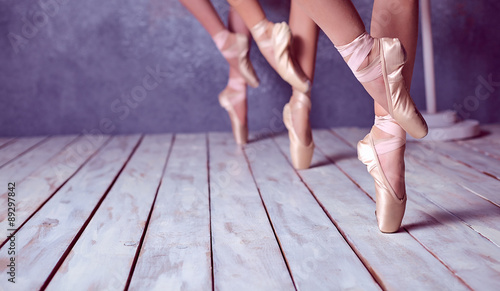 Photo  The feet of a young ballerinas in pointe shoes