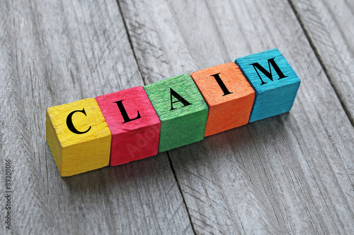 Photo word claim on colorful wooden cubes