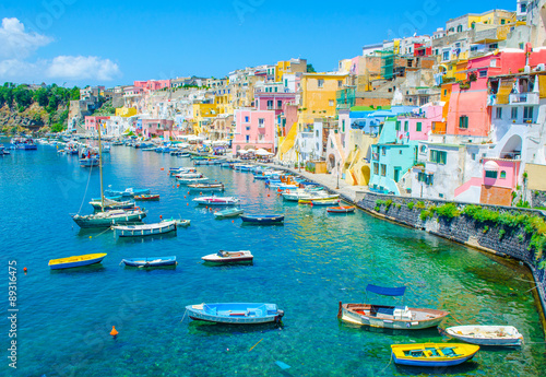 Poster Napels italian island procida is famous for its colorful marina, tiny narrow streets and many beaches which all together attract every year crowds of tourists coming from naples - napoli.