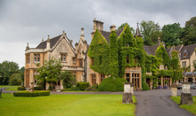 CHIPPENHAM, UK - AUGUST 9, 2014: Castle Combe, Unique Old English Village. Old House And Park