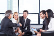 A group of businessmen discussing the policy of the company in t