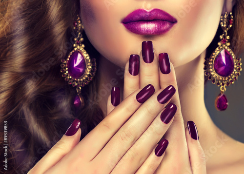 Poster Manicure Luxury fashion style, manicure nail , cosmetics and make-up . Jewelry , large purple earrings