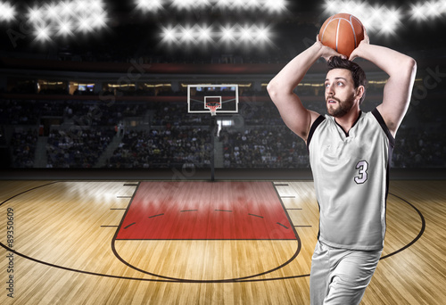 Photo  Basketball Player on a white uniform on white background