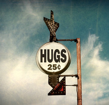 Aged And Worn Vintage Photo Of Hugs Sign