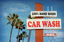 Aged And Worn Vintage Photo Of Car Wash Sign With Palm Trees