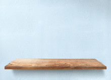 Wooden Table With Light Blue Wall