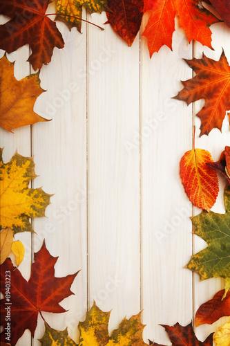 autumn leaf on wood background - 89403223