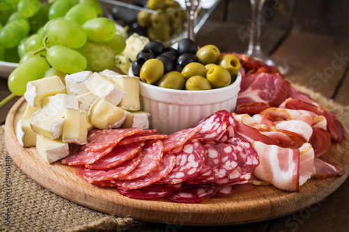 Recess Fitting Appetizer Antipasto catering platter with bacon, jerky, salami, cheese and grapes