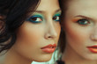 Beautiful couple of models with perfect arty make-up.