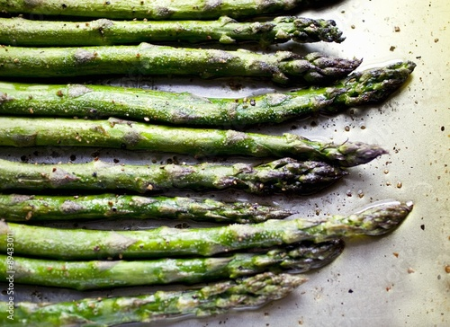 Valokuvatapetti Seasoned Asparagus Spears on Sheet Pan