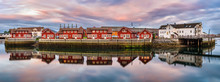 Red Harbor Houses In Svolvaer, Norway At Sunset