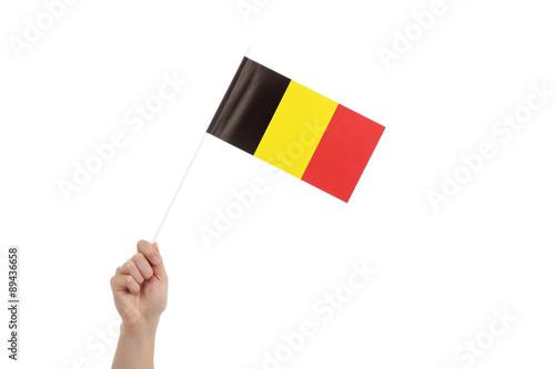 main femme tenant  petit drapeau belge Fototapet