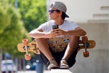 Handsome Skater Boy Using His ...