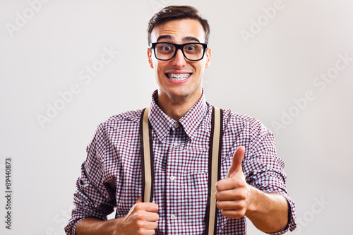 Nerdy man giving thumbs up Canvas Print