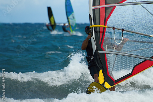 obraz lub plakat Three windsurfers in action