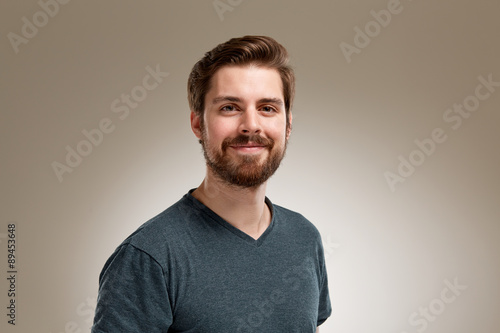 Portrait of smiling 20s man with beard