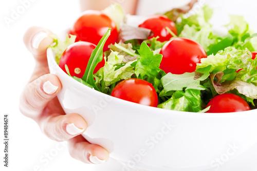 Tuinposter Groenten Salad bowl in woman hands