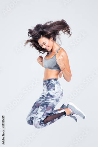 cheerful-fitness-woman-jumping