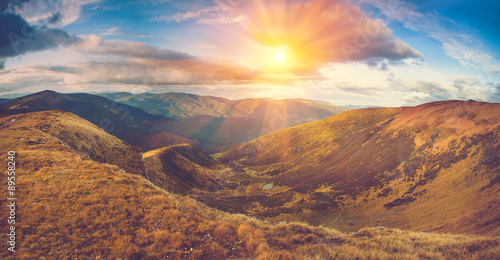 Scenic panoramic view of mountains. Autumn landscape:lake and colorful hills at sunset. #89558240