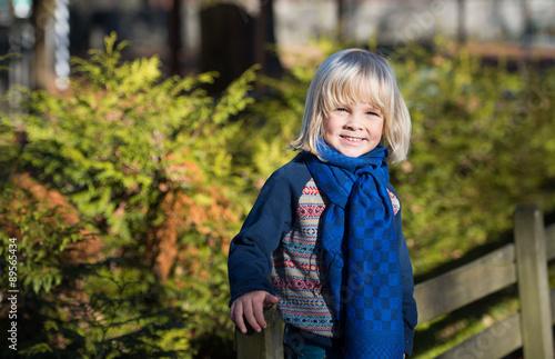 Photographie Portrait of adorable cute boy  in the beauty autumn park