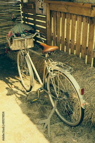 Deurstickers Fiets bicycle with basket flower -soft focus with vintage film filter