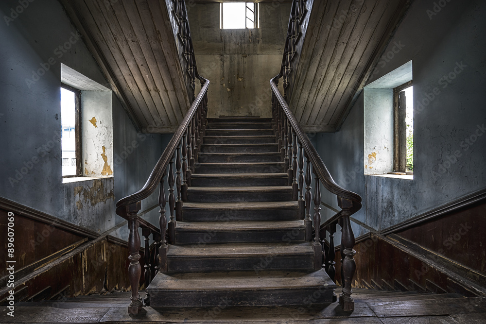 Fototapeta Wooden staircase in an abandoned house