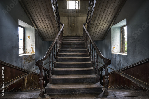 Wooden staircase in an abandoned house