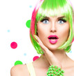 Surprised beauty fashion model girl with colorful dyed hair