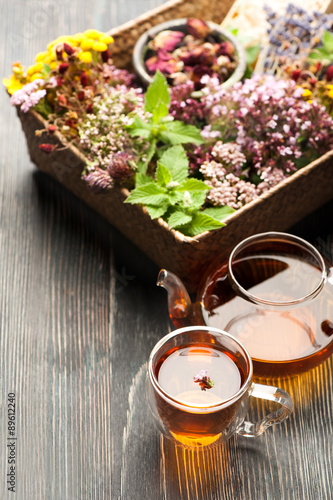 fototapeta na szkło Herbal tea, various herbs and flowers