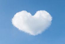 Heart Shaped Cloud In The Blue Sky. Valentines Day Background