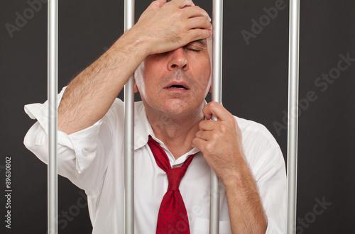 Fotografia, Obraz  Regretful businessman in prison