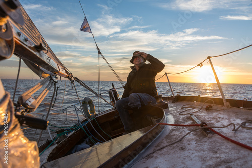 Spoed Foto op Canvas Zeilen Senior retired sailing Buenos Aires River to Uruguay. Sport free