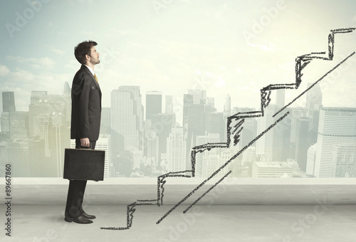 Fotografiet  Business man climbing up on hand drawn staircase concept