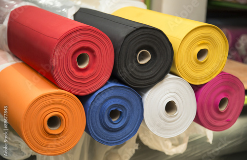 Foto op Canvas Stof Colorful material fabric rolls - texture samples