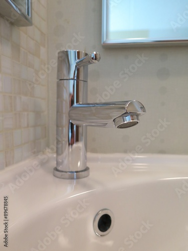 Restroom Fixtures: Sparking Clean Bathroom Faucet And Sink