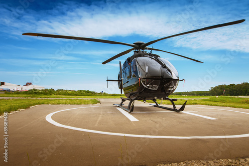 obraz dibond The helicopter in airfield