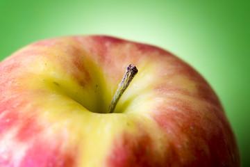 macro apple on green background