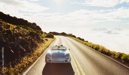 Photo  Coupe Driving on Country Road in Vintage Sports Car