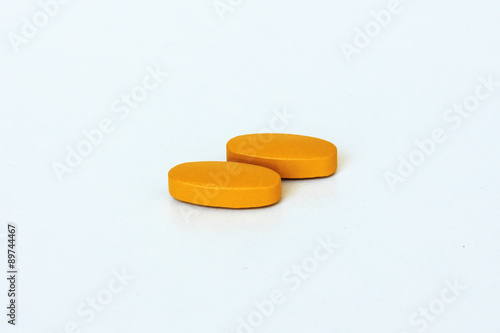 Film Coated Tablets of Vitamin C on White Background. Wallpaper Mural