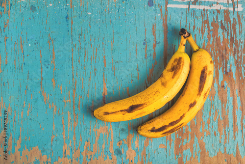 Valokuva  Bananas on rustic table